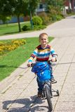 Happy boy learning to ride his first bike Royalty Free Stock Photos