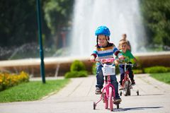 Happy boy learning to ride his first bike Royalty Free Stock Photography