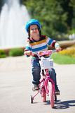 Happy boy learning to ride his first bike Stock Image