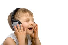 Happy Boy Listening with Headset Royalty Free Stock Photos