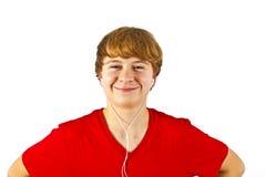 Happy boy listening to music Stock Photo