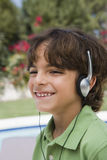 Happy Boy Listening To Music Royalty Free Stock Photo
