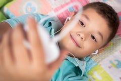 Happy boy listening to music Stock Photos