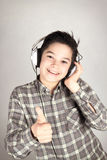 Happy Boy. Listening to music by headphones Royalty Free Stock Photography