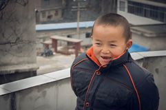 Happy Chinese rural boy  Royalty Free Stock Image