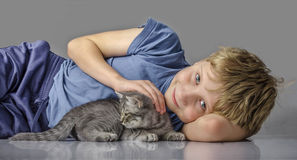 Happy boy with little kitten royalty free stock photo
