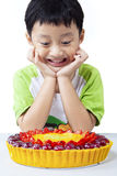 Happy Boy Looking at Fruit Cake Stock Images