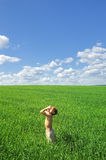 Happy boy looking to the sun on green field. Outdoor, nature scene Stock Photography
