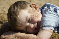 Happy boy lying on beach Royalty Free Stock Photos