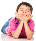 Happy boy lying on the floor Royalty Free Stock Photography