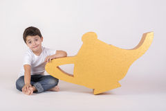 Happy boy with a magic lamp Royalty Free Stock Images