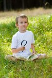 Happy boy with a magnifying glass Royalty Free Stock Photo