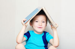 Happy boy making roof with book Stock Photography