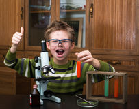 Happy boy making science experiments. Education. Royalty Free Stock Photos