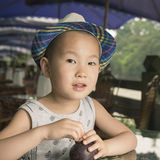 Happy boy with mangosteen Royalty Free Stock Images