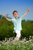 Happy boy on meadow Royalty Free Stock Photo
