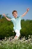 Happy boy on meadow Royalty Free Stock Photo