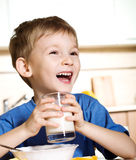 Happy boy with milk Royalty Free Stock Photography