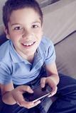 Happy boy with mobile phone. Happy boy smiling with mobile phone Stock Image