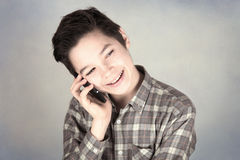 Happy boy on mobile phone. Happy and smilling boy on mobile phone Royalty Free Stock Photo