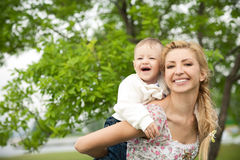 Happy boy with mom Stock Photography