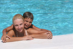 Happy boy and mom in the swimming pool Royalty Free Stock Photos