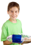 Happy boy with money and house on the tray. Isolated royalty free stock photography