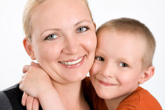 Happy boy with mother. Smiling little son embracing his mother royalty free stock photography