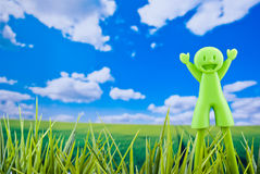 Happy boy in natural background. Happy green boy puppet in natural background blue sky Royalty Free Stock Image
