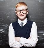 Happy Boy near blackboard Stock Photos