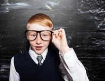 Happy Boy near blackboard Royalty Free Stock Image
