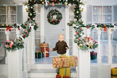 Happy boy near Christmas gifts Royalty Free Stock Photography