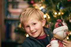 Happy boy near Christmas tree stock photos