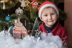 Happy boy near Christmas tree royalty free stock photography