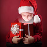 Happy boy open christmas gift-box Stock Images