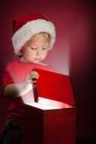 Happy boy open gift-box Royalty Free Stock Photography