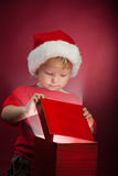 Happy boy open gift-box Stock Photography