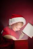 Happy boy open gift-box Stock Image
