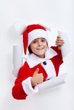 Happy boy opening christmas season Royalty Free Stock Photography