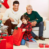 Happy boy opening gifts at Stock Image