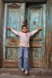 Happy boy opening his arms. In front of his house door stock photos