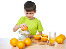 Happy boy with orange and juicer isolated Stock Images