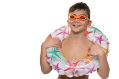 Happy boy with orange swimming goggles and inflatable circle, concept of rest and sport, on a white background, copy space. Happy boy with orange swimming royalty free stock photos