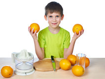 Happy boy with oranges and juicer isolated Stock Photography