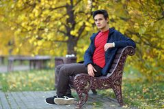 Happy boy outdoors in autumn city park royalty free stock photography
