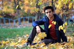 Happy boy outdoors in autumn city park royalty free stock photos