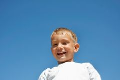 Happy boy over blue Stock Images