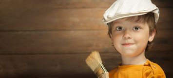 Happy boy with paint brush.  stock photo