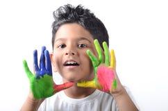 Happy boy with paint having fun Stock Image