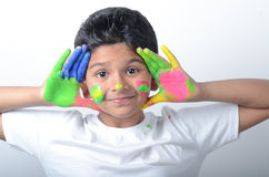 Happy boy with paint having fun Stock Photo